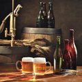 Beer still life on the table with old kegs tap Royalty Free Stock Photography