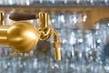 Beer tap detail with handle amde from gold metal Stock Photo