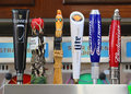 Beer tap handles several sizes and brands of Royalty Free Stock Photos