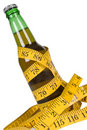 Beer with tape measure Royalty Free Stock Photos