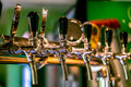 Beer taps in a pub. Royalty Free Stock Photo