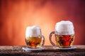 Beer. Two cold beers. Draft beer. Draft ale. Golden beer. Golden ale. Two gold beer with froth on top. Draft cold beer in glass ja Royalty Free Stock Photo