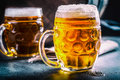 Beer. Two cold beers. Draft beer. Draft ale. Golden beer. Golden ale. Two gold beer with froth on top. Draft cold beer in glass. Royalty Free Stock Photo