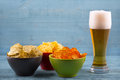 Beer and various types of chips Royalty Free Stock Photo
