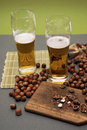 Beer and woods nuts Stock Photo