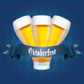 Beers abstract and oktoberfest text on special blue background Stock Photography