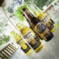Beers on the deck corona and samuel adams octobrefest sit a glass pato table an outdoor angle shot square layout editorial use Royalty Free Stock Photos