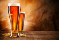 Beers glasses of beer on wooden table Stock Photo