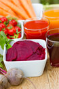 Beet and beet juice tomato carrot Stock Photo