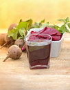 Beet juice and root on a table Royalty Free Stock Photos