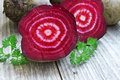 Beet raw slice with parsley leaves near healthy root vegetables Stock Photos