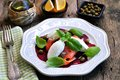 Beet salad, soft cheese and smoked salmon with capers and olive oil. Royalty Free Stock Photo