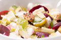 Beet walnut salad tasty and with goat cheese crumbled on top Royalty Free Stock Image