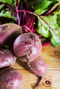Beetroot close up on fresh organic raw against a wooden background copy space Royalty Free Stock Photos