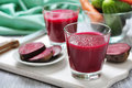 Beetroot juice in glass on wooden cutting board Royalty Free Stock Photos