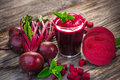 Beetroot juice on wooden background Stock Images