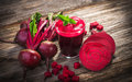 Beetroot juice on wooden background Royalty Free Stock Photos