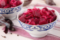 Beetroot marinated with onions and peppers two bowls slices of pickled beets Stock Image