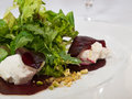 Beetroot salad marinated stuffed with whipped goat cheese and pistachio nuts Stock Photo