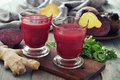 Beetroot smoothie with ginger in glass and fresh vegetables on wooden background Stock Image