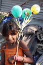 Beggar Girl with Balloons Royalty Free Stock Photos