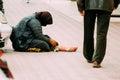 Beggar on sidewalk old woman in romania Royalty Free Stock Image