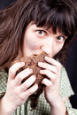 Beggar woman eating bread Royalty Free Stock Image