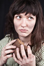 Beggar woman with a piece of bread Royalty Free Stock Image