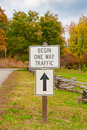 Begin one way traffic sign in a park autumn Royalty Free Stock Images
