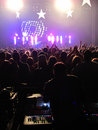 Behind mixer in concert audio technician a a crowd Stock Photography