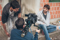 Behind the scene. Film crew filming movie scene outdoor Royalty Free Stock Photo