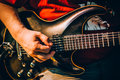 Behind scene. Guitarist practice playing guitar in messy music s Royalty Free Stock Photo