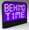 Behind time clock shows running late or overdue showing Royalty Free Stock Photo