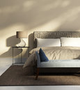 Beige bedroom with a bench Royalty Free Stock Photo