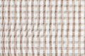 Beige checkered fabric. Tablecloth texture Stock Photography