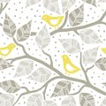 Beige gray leaves and yellow birds on branches on dotted white background seasonal seamless pattern Stock Photography