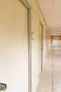 Beige hospital hallway; empty hospital corridor; hospital interi Royalty Free Stock Photo