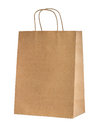 Beige paper shopping bag with handles isolated on a white background Royalty Free Stock Photo