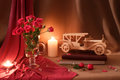 Beige pink still life with roses, candles and vintage car