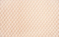 Beige quilted pattern background Royalty Free Stock Photo