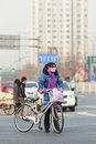 Beijing Resident with smog protection Stock Photos