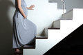 Being careful during pregnancy up to the stairs Stock Photos