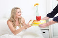 Being treated to breakfast in bed Stock Images