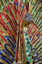 Bejeweled peacock statue in red green and blue feathers and diamante head with a golden beak in buddhism peacocks symbolize purity Royalty Free Stock Image