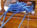 Belaying cleat a blue rope on a of a wooden ship Stock Photos