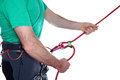 Belaying mountaineer is with rope on white background Royalty Free Stock Image