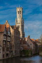 Belfried bruges the in behind historical houses Royalty Free Stock Image