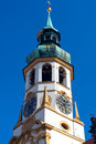Belfry of the church loreta is an ornate baroque most famous for legend that surrounds building small santa casa chapel which Royalty Free Stock Photo