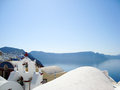 Belfry in oia santorini summer view of typical and calm blue sea greece Royalty Free Stock Photos