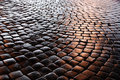 Belgian block pavement of the night city granite cobblestones are photographed at Stock Images